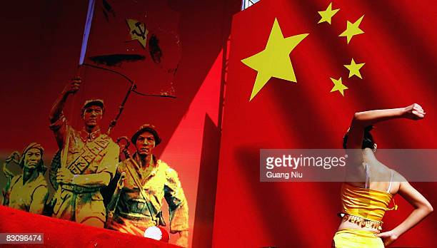 Chinese entertainer prepares to perform during a celebration to mark China's National Day the anniversary of the founding of communist China in 1949...