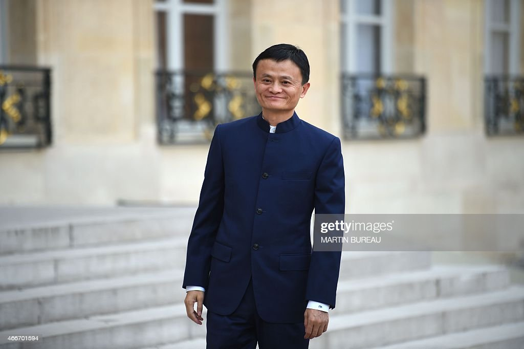 Chinese entrepreneur and founder of internet retail group Alibaba, Jack MA, looks on as he arrives for a meeting with French President Francois Hollande at the Elysee Palace in Paris on March 18, 2015.