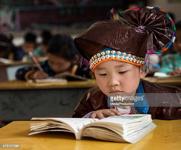 Chinese Ethnic Minority Child in traditional clothes at school