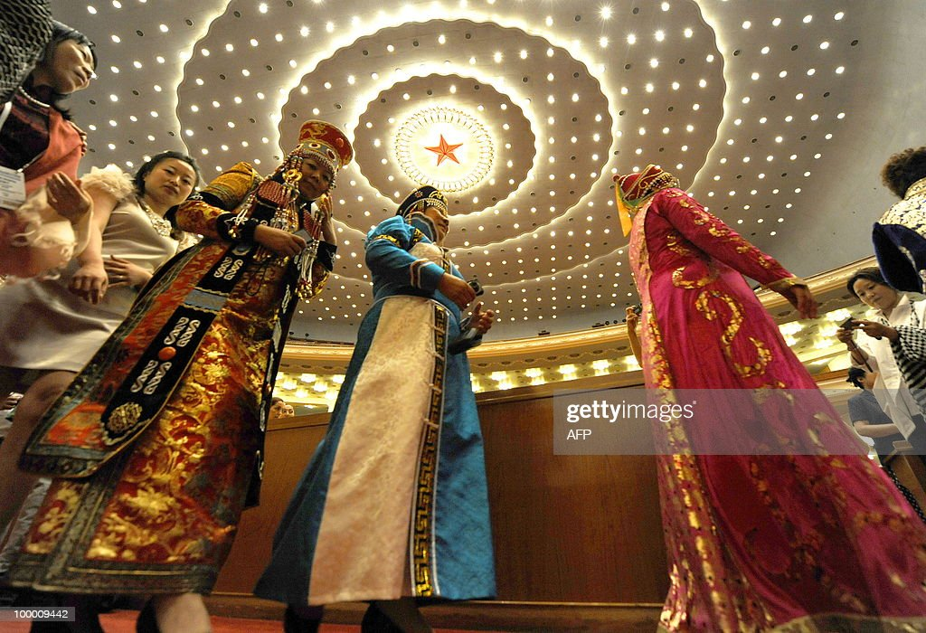 Chinese ethnic Mongolian delegates arrive for the opening ceremony of the 20th Global Summit of Women at the Great Hall of the People in Beijing on May 20, 2010. More than 1,000 women delegates from 80 countries participate in the Global Summit of Women in China's capital from May 20-22, 2010. AFP PHOTO/LIU Jin
