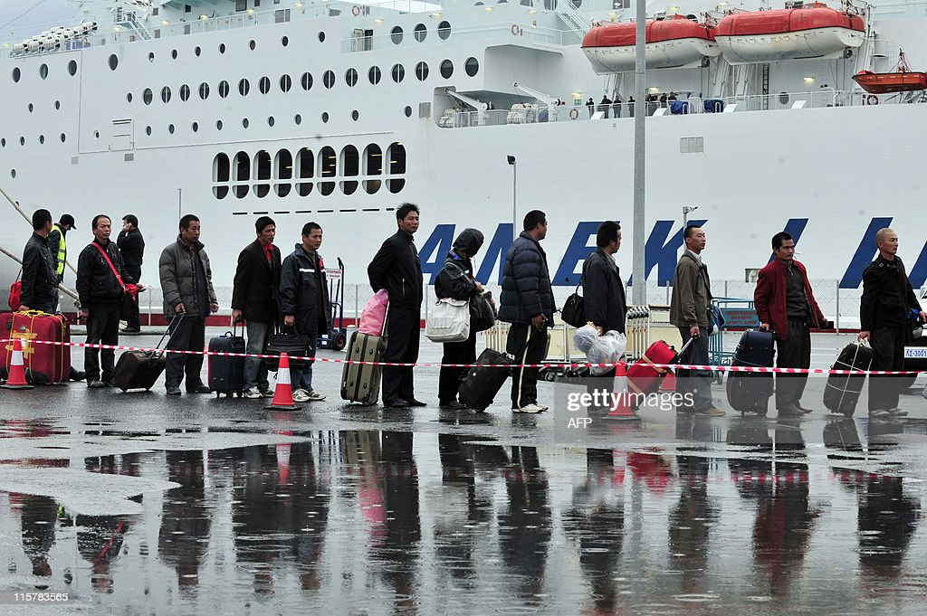 Chinese evacuees from Libya arrive at the port of Heraklion, on Crete island on February 24, 2011. Thousands of Chinese and scores of Europeans began landing Thursday at the port of Heraklion on the Greek island of Crete after their evacuation from unrest-hit Libya aboard chartered Greek ferries. The first boat from the Libyan port of Benghazi, the ferry Hellenic Spirit, reached Heraklion after 1200 GMT and was followed by the ferry Olympic champion, an AFP photographer reported. AFP PHOTO / Aris Messinis