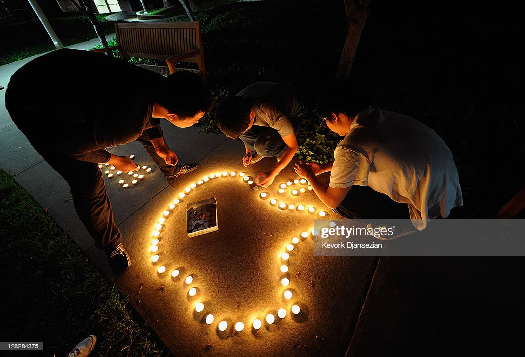 Chinese exchange students from nearby De Anza College use candles to create the Apple logo and Steve Jobs' last name in Chinese characters at a makeshift memorial for Steve Jobs at the Apple headquarters on October 5, 2011 in Cupertino, California. Jobs, 56, passed away after a long battle with pancreatic cancer. Jobs co-founded Apple in 1976 and is credited, along with Steve Wozniak, with marketing the world's first personal computer in addition to the popular iPod, iPhone and iPad.
