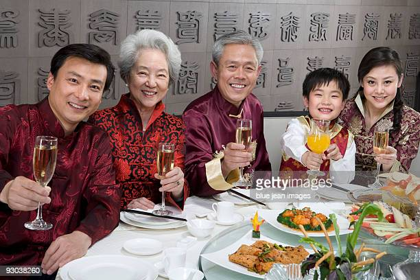 Chinese family celebrating at Chinese restaurant