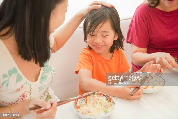 Chinese family eating with chopsticks