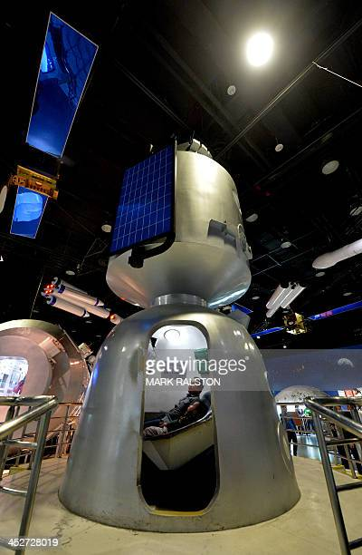 A Chinese family inside a spacecraft simulator at the Science Museum in Beijing December 1 2013 China's state media and people eagerly awaited the...
