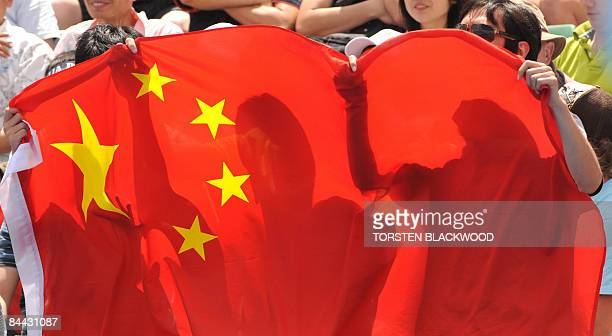 Chinese fans attend the Zheng Jie of China versus Kateryna Bondarenko of the Ukraine women's singles tennis match on the sixth day of the Australian...