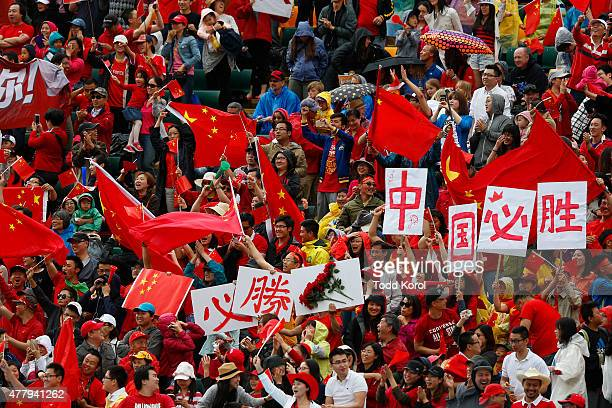 Chinese fans celebrate after their team's first goal in their match against Cameroon during the FIFA Women's World Cup Canada Round 16 match between...