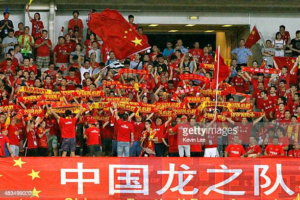 Chinese fans cheer before the match between China and Japan of the EAFF East Asian Cup 2015 final round at the Wuhan Sports Center Stadium on August...