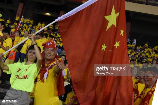 Chinese fans cheer during the 2018 FIFA World Cup Asian Qualifier Group A Final Round match between Syria and China at Hang Jebat Stadium on June 13...