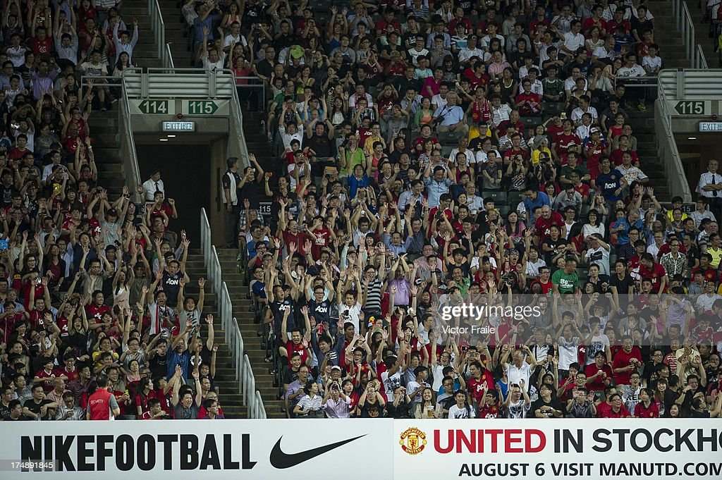 Chinese fans cheer during the international friendly match between Kitchee FC and Manchester United at Hong Kong Stadium on July 29, 2013 in So Kon Po, Hong Kong.