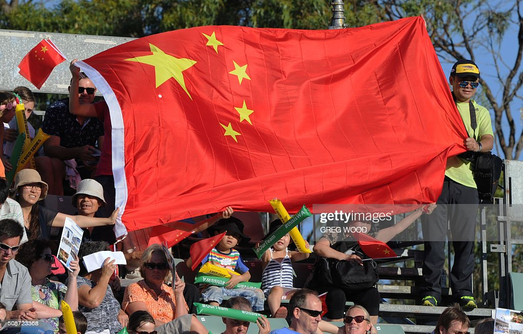 Chinese fans cheer on their team during the final day of the Aquatic Super Series swimming event in Perth on February 6, 2016. AFP PHOTO / Greg WOOD WOOD