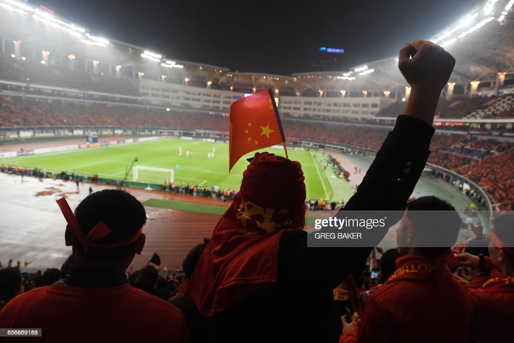 Chinese fans cheer their team during their World Cup football qualifying match against South Korea, in Changsha, in China's central Hunan province on March 23, 2017. /