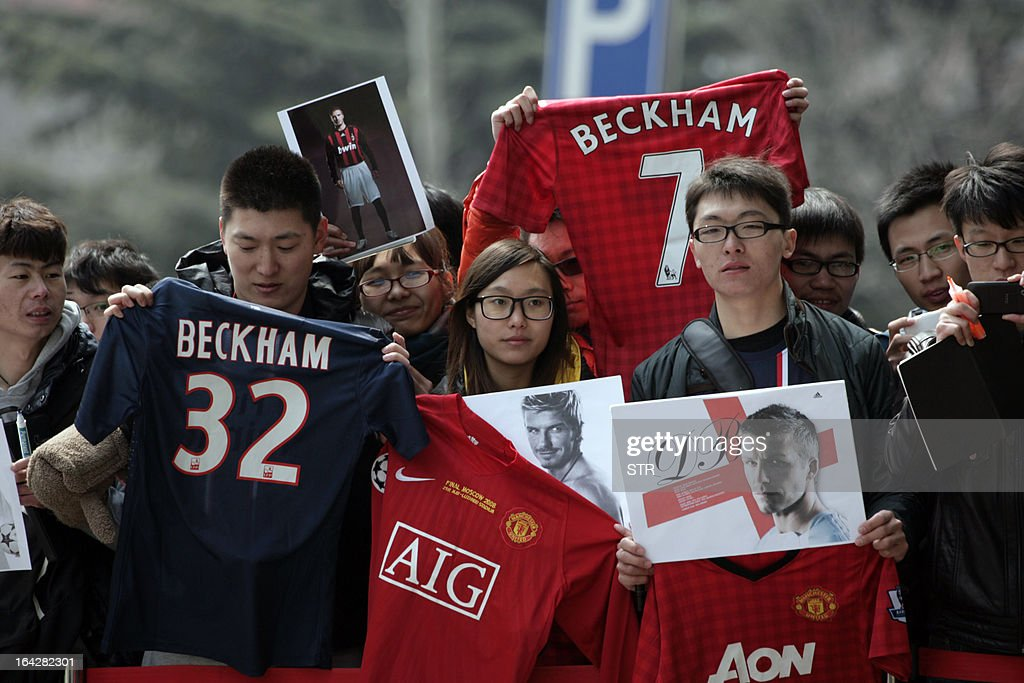 Chinese fans of football superstar David Beckham wait for his arrival in Qingdao, east China's Shandong province on March 22, 2013. Beckham raised the prospect of one last stop on his global football journey, refusing to rule out playing in China after his contract with Paris Saint-Germain ends. CHINA