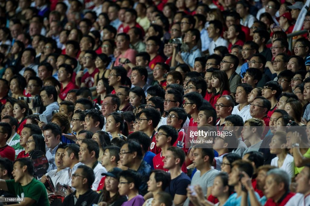Chinese fans watch the action during the international friendly match between Kitchee FC and Manchester United at Hong Kong Stadium on July 29, 2013 in So Kon Po, Hong Kong.