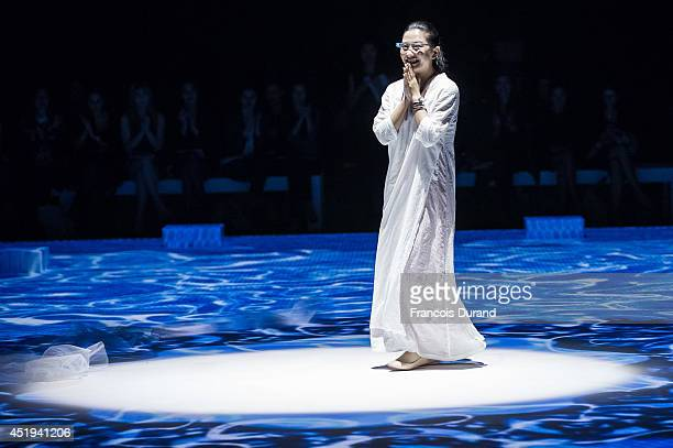 Chinese fashion designer Lan Yu attends the Lan YU show as part of Paris Fashion Week Haute Couture Fall/Winter 20142015 at Grand Palais on July 9...