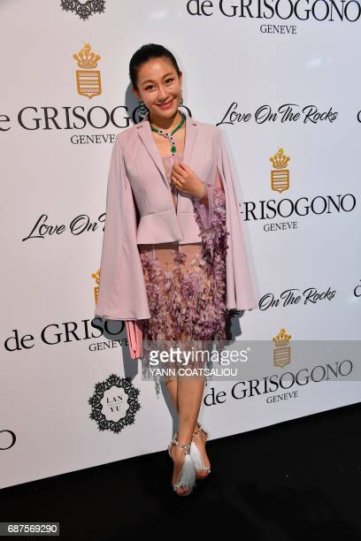 Chinese fashion designer Lan Yu poses during a photocall as she arrives to attend the De Grisogono Party on the sidelines of the 70th Cannes Film...