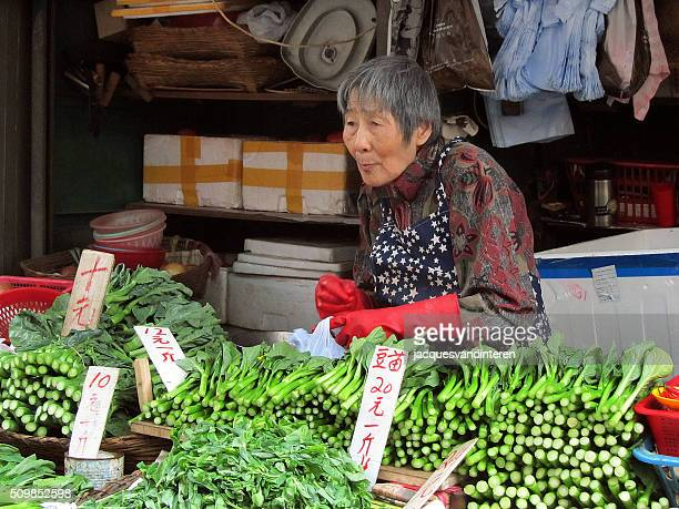 Chinese female vendor in market stall