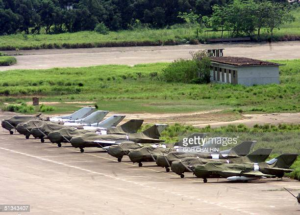 Chinese fighter jets line up on the tarmac of the People's Liberation Army South China Naval and Airforce base in Haikou on China's Hainan island 08...