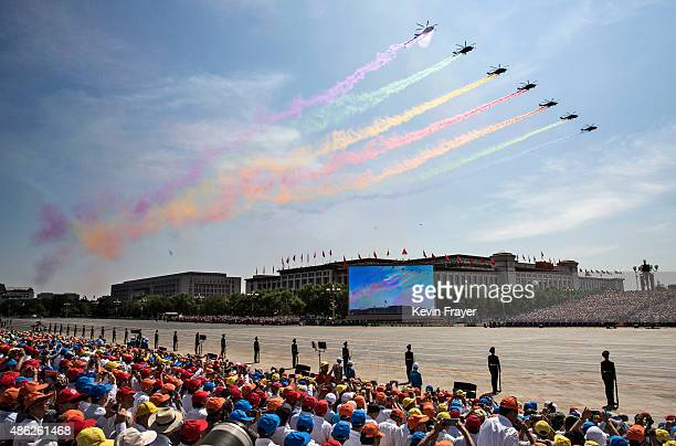 Chinese fighter planes fly in formation over Tiananmen Square during a military parade on September 3 2015 in Beijing China China is marking the 70th...
