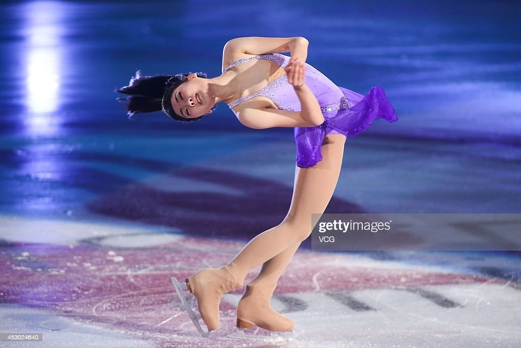 Chinese figure skater <a gi-track='captionPersonalityLinkClicked' href=/galleries/search?phrase=Li+Zijun&family=editorial&specificpeople=7380389 ng-click='$event.stopPropagation()'>Li Zijun</a> performs during Artistry On Ice 2014 at Guangzhou international sports and entertainment center on August 1, 2014 in Guangzhou, China.