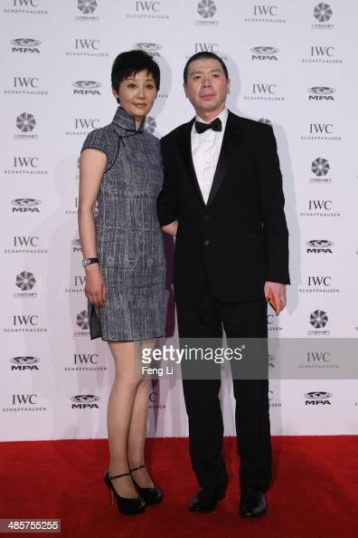 Chinese film director Feng Xiaogang and his wife actress Xu Fan arrive at the exclusive 'For the Love of Cinema' event hosted by IWC Schaffhausen in...