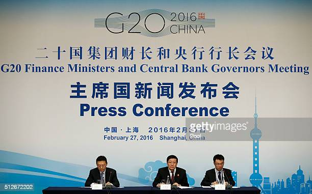 Chinese Finance Minister Lou Jiwei holds a press conference with a moderator and interpreter after sessions of the G20 Finance Ministers and Central...