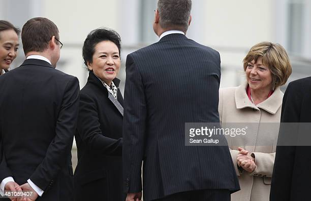 Chinese First Lady Peng Liyuan and German First Lady Daniela Schadt lgreet members of the German Presidential Office at Schloss Bellevue on March 28...