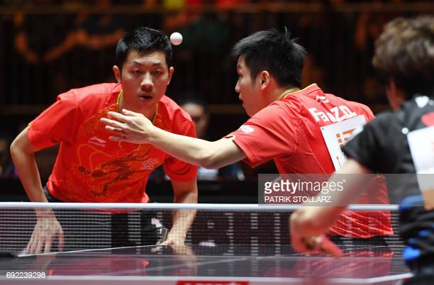 Chinese first placed men´s doubles Xu Xin and Fan Zhendong plays against Japanese Masataka Morizono and Yuya Oshima during the final of the WTTC...