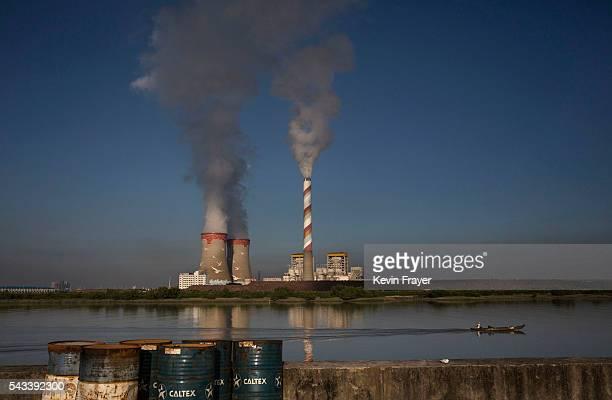 Chinese fisherman passes a coal powered plant on Shazai Island where the Sun YatSen UniversityMichigan University Joint Center of Vector Control for...