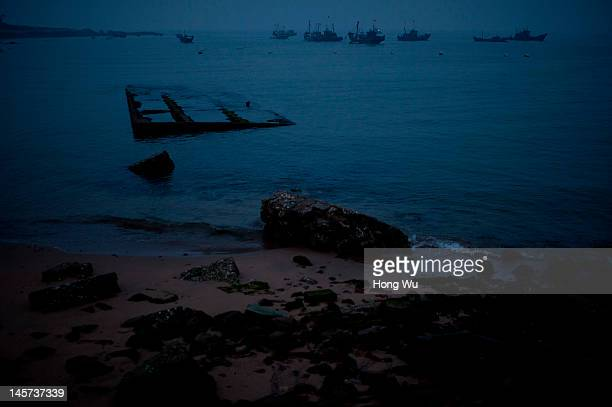 Chinese fishermen on fishing boats set off for fishing in the morning on May 28 2012 in Qingdao China Marine fishery resources in China becomes less...