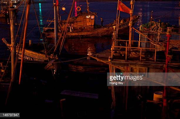 Chinese fishermen on fishing boats set off for fishing in the morning on May 27 2012 in Qingdao China Marine fishery resources in China becomes less...
