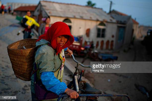 Chinese fisherwoman at a port on May 21 2012 in Qingdao China Marine fishery resources in China becomes less and lees due to excessive fishing and...
