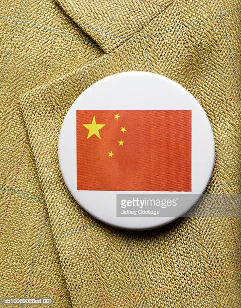 Chinese flag button on jacket, close-up