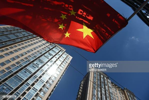 A Chinese flag flies near apartment buildings in Beijing on September 11 2015 The Chinese government is capable of maintaining high economic growth...