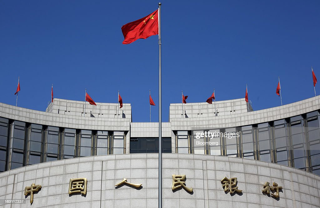 A Chinese flag flies outside the People's Bank of China (PBOC) headquarters stands in Beijing, China, on Monday, March 4, 2013. China maintained its economic-growth target at 7.5 percent for 2013 while setting a lower inflation goal of 3.5 percent, setting up a challenge for new leaders to keep prices in check without harming expansion. Photographer: Tomohiro Ohsumi/Bloomberg via Getty Images