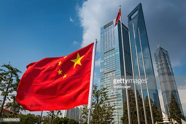 Chinese flag flying beside futuristic Shanghai skyscrapers