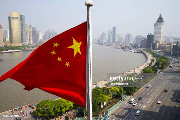 Chinese flag overlooking cityscape, Shanghai, China