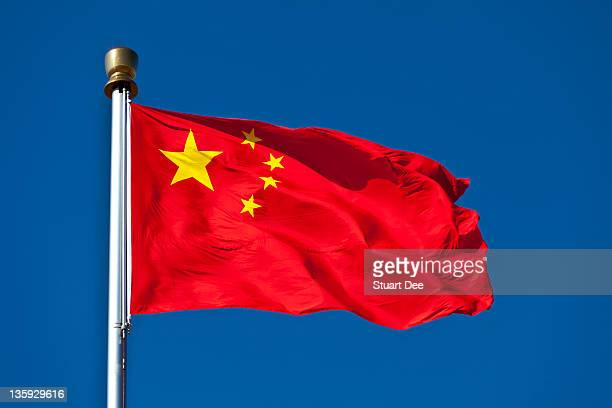 Chinese flag waving against blue sky