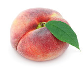 Chinese flat donut peach with leaf isolated on white with clipping path