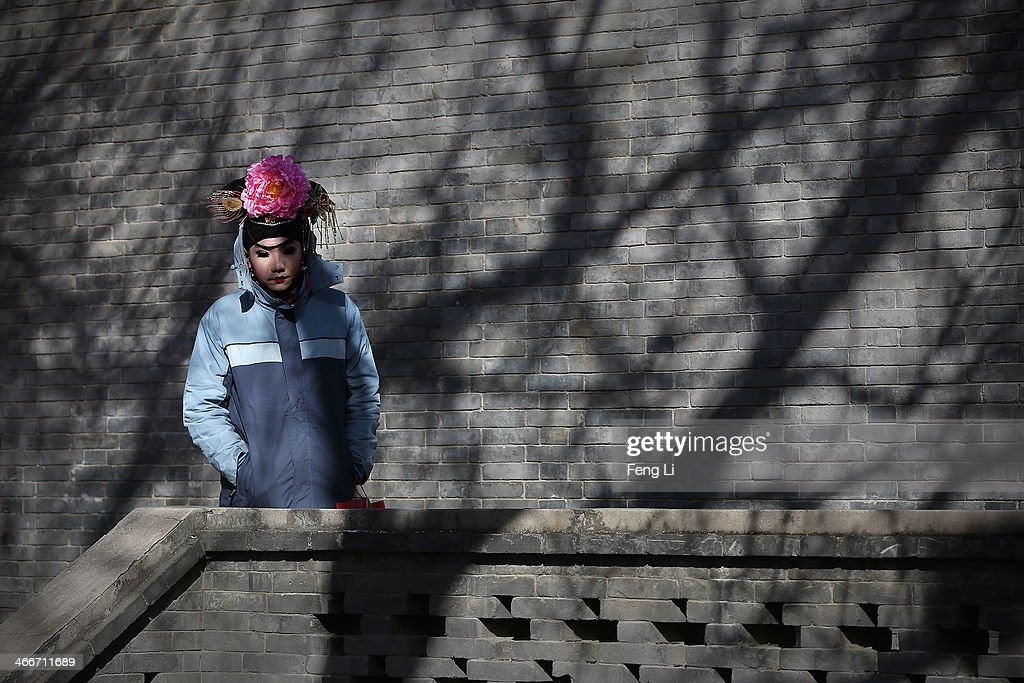 A Chinese folk artist waits to perform during the Spring Festival Temple Fair at Longtanhu Park on the fourth day of the Chinese Lunar New Year of Horse on February 3, 2014 in Beijing, China. The Chinese Lunar New Year of Horse also known as the Spring Festival, which is based on the Lunisolar Chinese calendar, is celebrated from the first day of the first month of the lunar year and ends with Lantern Festival on the Fifteenth day.