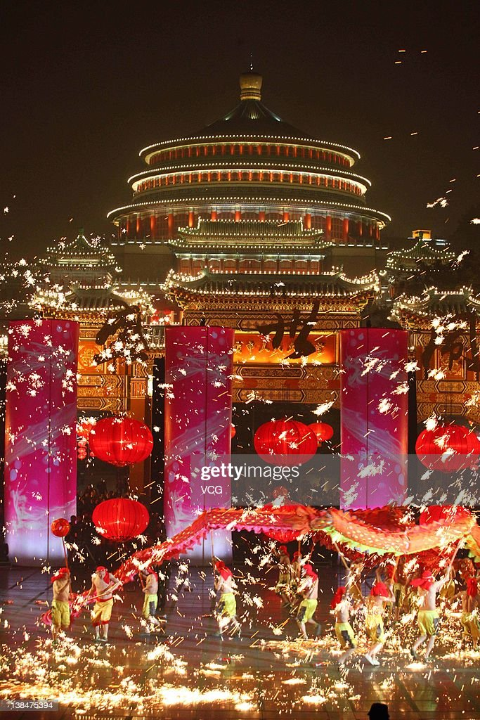 Chinese folk artists perform a dragon dance as sparks fly from fireworks to celebrate the Lantern Festival on February 6, 2012 in Chongqing, China. The Lantern Festival, which falls on the 15th day of the first month of the Lunar New Year, will fall on February 6, 2012.