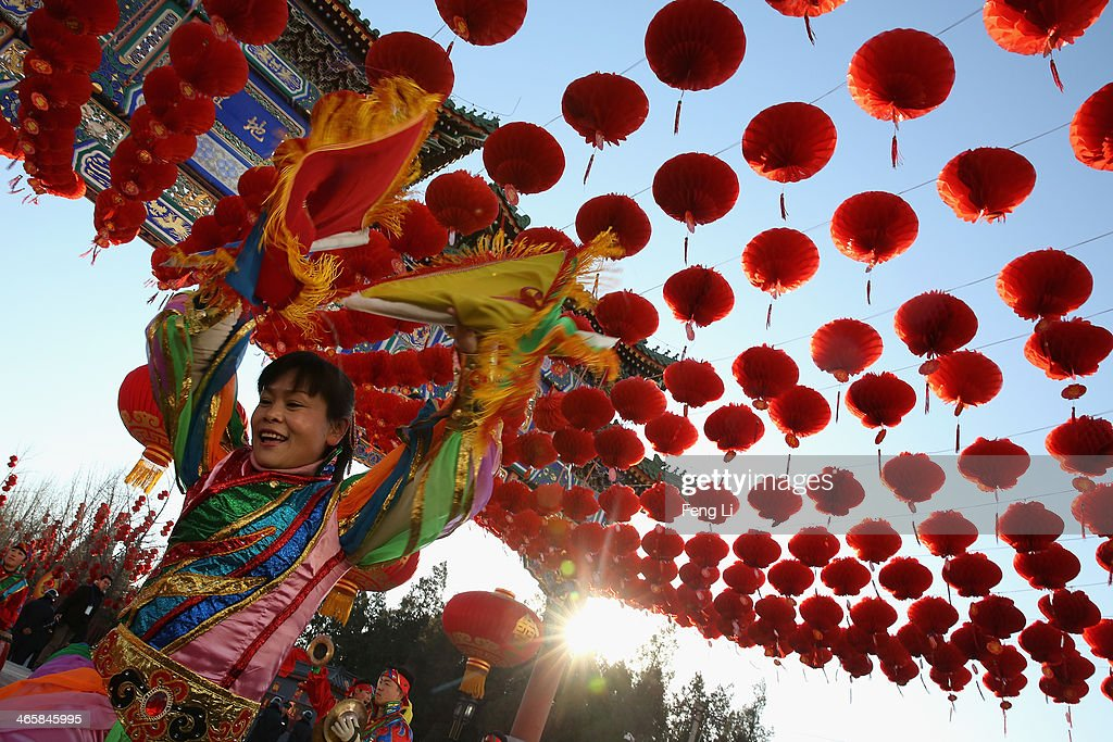 Chinese folk artists perform during the opening ceremony of the Spring Festival Temple Fair at the Temple of Earth park on January 30, 2014 in Beijing, China. The Chinese Lunar New Year of Horse also known as the Spring Festival, which is based on the Lunisolar Chinese calendar, is celebrated from the first day of the first month of the lunar year and ends with Lantern Festival on the Fifteenth day.