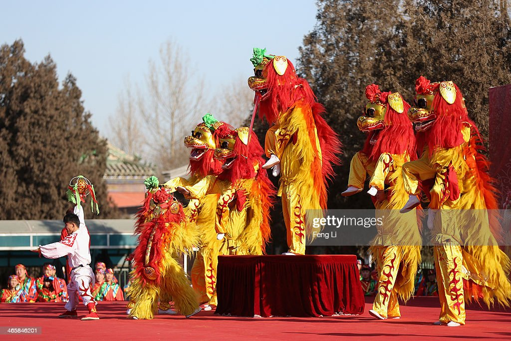 Chinese folk artists perform during the Spring Festival Temple Fair at the Temple of Earth park on January 30, 2014 in Beijing, China. The Chinese Lunar New Year of Horse also known as the Spring Festival, which is based on the Lunisolar Chinese calendar, is celebrated from the first day of the first month of the lunar year and ends with Lantern Festival on the Fifteenth day.