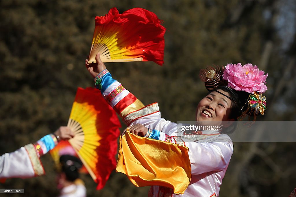Chinese folk artists perform during the Spring Festival Temple Fair at Longtanhu Park on the fourth day of the Chinese Lunar New Year of Horse on February 3, 2014 in Beijing, China. The Chinese Lunar New Year of Horse also known as the Spring Festival, which is based on the Lunisolar Chinese calendar, is celebrated from the first day of the first month of the lunar year and ends with Lantern Festival on the Fifteenth day.