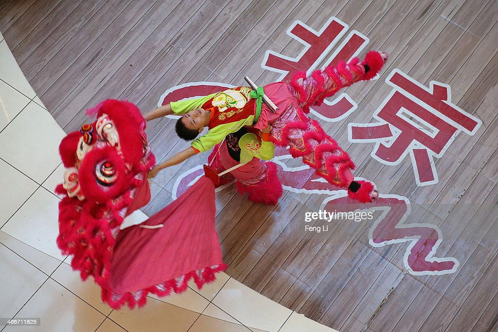 Chinese folk artists perform the lion dance in a shopping mall on the fourth day of the Chinese Lunar New Year of Horse on February 3, 2014 in Beijing, China. The Chinese Lunar New Year of Horse also known as the Spring Festival, which is based on the Lunisolar Chinese calendar, is celebrated from the first day of the first month of the lunar year and ends with Lantern Festival on the Fifteenth day.