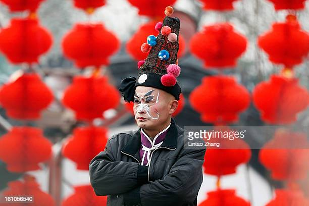 Chinese folk artists prepare to perform during the opening ceremony of the Spring Festival Temple Fair at Dragon Lake Park on February 9 2013 in...