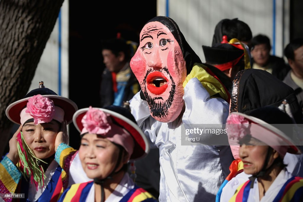 Chinese folk artists wait to perform during the Spring Festival Temple Fair at Longtanhu Park on the fourth day of the Chinese Lunar New Year of Horse on February 3, 2014 in Beijing, China. The Chinese Lunar New Year of Horse also known as the Spring Festival, which is based on the Lunisolar Chinese calendar, is celebrated from the first day of the first month of the lunar year and ends with Lantern Festival on the Fifteenth day.