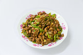 Chinese food - green pepper, pork and peanuts fried together
