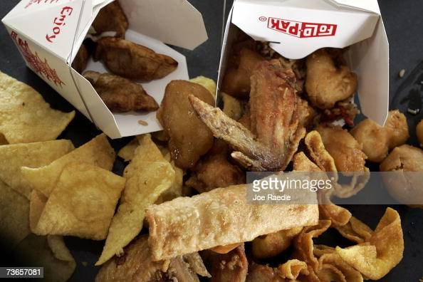 Chinese food including fried chicken wings fried wonton fried rice fried egg roll and fried dumplings sit on a table March 21 2007 in Miami Florida A...