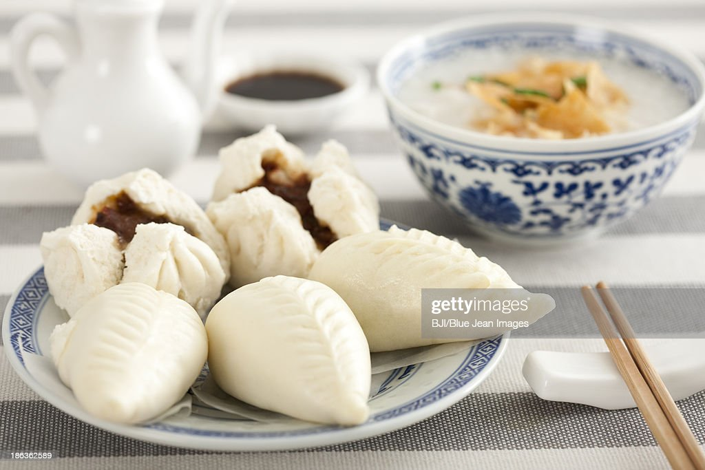 Chinese food rice porridge and cantonese barbecued pork buns : Stock Photo